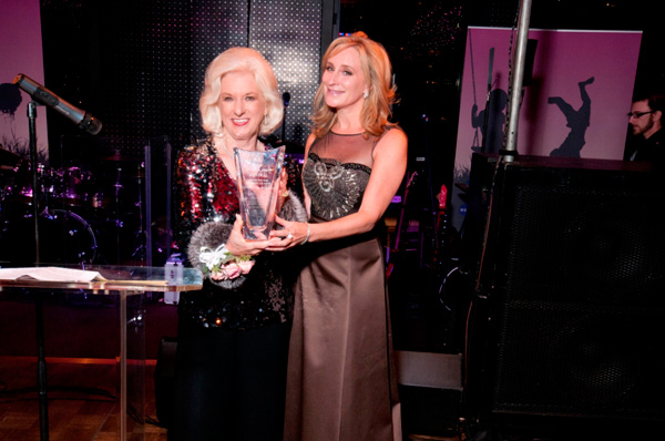 Ann Deal received her H.U.G. Award crystal from emcee Sonja Morgan.